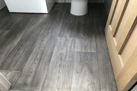 WoodLike vinyl flooring Installed to Bathroom